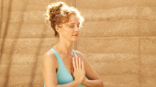 woman meditating in the sunlight