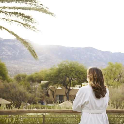 Woman enjoying the mountain view at our resort in Tucson, Arizona