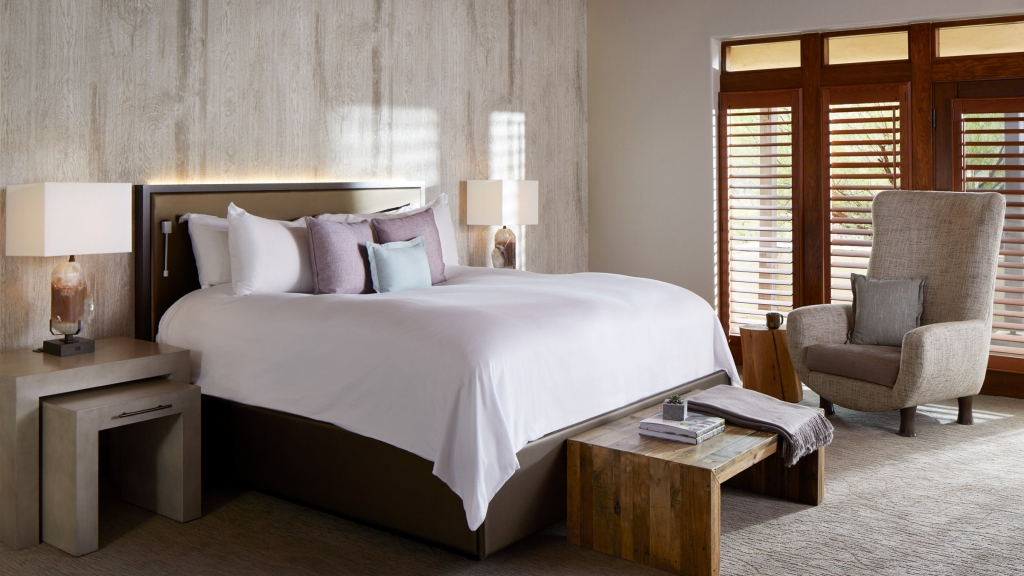 freshly-made bed at miraval arizona resort & spa