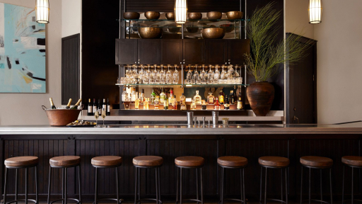 View of full bar with stools and drinks at Miraval Arizona.